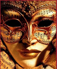 Gold eye mask with sheet music design