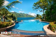 #Hilton #Seychelles - Surrounded by lush tropical foliage and spectacular island views, the outdoor #pool at the Hilton Seychelles Resort is the ultimate spot to bask in the sun and simply let the cares of the world fade away. View more stunning photography from VRX Studios here: http://www.vrxstudios.com