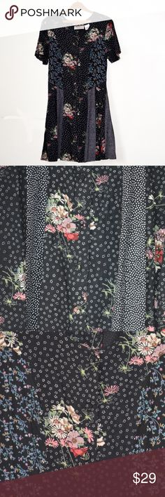 Vintage Floral 90s Dress This is a vintage floral dress, with beautiful mismatched patterns. It is a button down, and ties in the back to create a bit of a cinched look. These is padding on the shoulders.  Size: 11/12  Material: Rayon Pellini Dresses Dresses