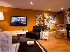 HGTV Design Star contestant Blanche Garcia wanted the main living space in this New Jersey bachelor pad to feel young, vibrant and fun for when the homeowner is entertaining friends. She creates a focal wall of burnt orange. To bring a little New York City into the design, Garcia commissions artwork by a graffiti artist for the living room.