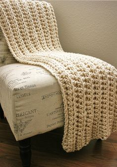 """This throw is done with rows of HDC worked in back loops only, using bulky (weight class 5) or super-bulky (weight class 6) acrylic yarn & probably hook size P.  The picture shows it folded in half, seller says it's about 43"""" x 60"""".   Super-easy & very fast, would make an impressive gift.  #crochet #afghan #blanket"""
