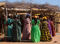 Herero tribe fashion of Namibia. late 19th century German fashion meets African prints and color palettes.