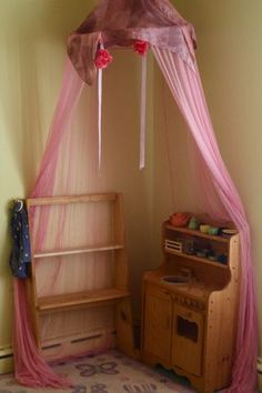 Julianna's wooden play kitchen with silk Rose Canopy from Bella Luna Toys. www.bellalunatoys.com