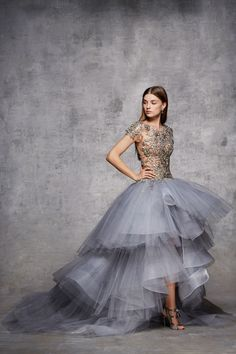 Illusion neckline cap sleeve tiered tulle ballgown with silver and gunmetal metallic encrusted 3D flowers.