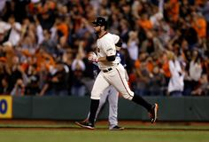 San Francisco Giants' Brandon Belt (9) circles the bases after hitting a solo home run against the San Diego Padres in the second inning at AT&T Park in San Francisco, Calif., on Thursday, Sept. 25, 2014.  (Nhat V. Meyer/Bay Area News Group)