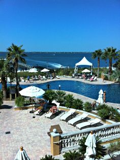 Palm-lined pool and stunning view at Portofino Island Resort in Pensacola Beach