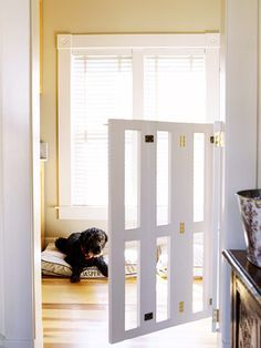nice custom gate! This gate folds when not in use (notice the hinges in the middle) Dog Station, Baby Gates, Dog Gates, Custom Gates, Animal Room, Pet Gate, Dog Rooms, Dog Shower, Diy Stuffed Animals