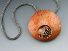 Polymer layers with copper disc by Stonehouse Studio