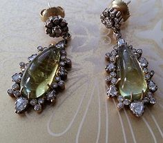 Burmese cabochon Chrysoberyl 22.24cts & diamond 2.16cts earrings.