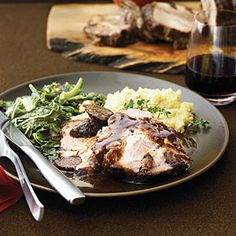 """PORK SHOULDER ROAST w/ FIGS, GARLIC & PINOT NOIR - """"Stuffing this roast with figs and garlic slivers will make you feel like a modern-day Julia Child, and the results are stunning: mosaic-like slices infused with rich fruit and wine flavors."""""""