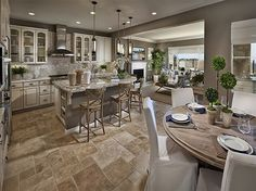 Cream and tan link this kitchen and great room. Ryland Homes. San Diego, CA.