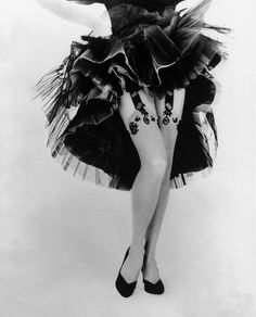 Gordon Parks: Fancy garters-fashion shot of elaborate garter. 1954