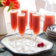 This Sunrise Bellini is what every mom really wants this mother's day! Mix up a pitcher of these easy beverages for a brunch treat.