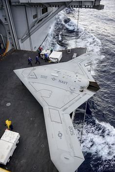 The Navy's stealthy unmanned aerial vehicle (UAV) is the size of a fighter jet, and will be taking off and landing from the deck of an aircraft carrier. Military Jets, Military Weapons, Military Aircraft, Navy News, Photo Avion, Navy Ships, Jet Plane, Aircraft Carrier, Us Navy