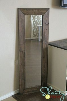 Dollar store mirror with wood around edges.