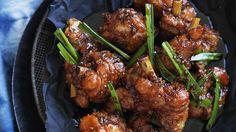 Crispy Chinese-style chicken legs Recipe Main Dishes with spring onions, caster sugar, ground white pepper, kecap manis, Shaoxing wine, garlic chives, chopped garlic, vegetable oil, fresh ginger, chicken drumsticks, soy sauce, chicken