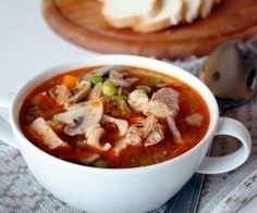 The soup of pork with mushrooms and peas.