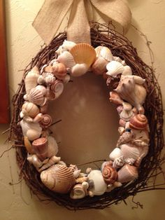 Seashell Wreath with Burlap Bow by Country by CountryChicbyChloe    Cute, unique wreath! Beach house wreath! Country chic!