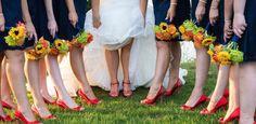 Orange bridesmaid bouquets.