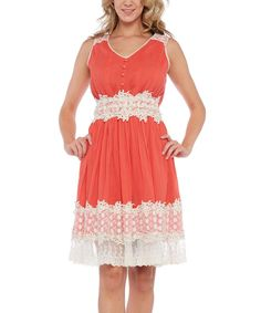 Crocheted flowers accent this soft cotton shift dress styled with a shirred waistline for a feminine shape.