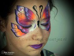 Multicolor butterfly on the beautiful Luna. www.blije-snoetjes.nl www.facebook.com/BlijeSnoetjesKinderschmink