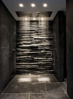 Pin 9: This beautiful open shower has the feel of a waterfall. The stack stone effect o the far back wall looks very nice. Although, it could be very dangerous if someone were to slip and fall into that wall.