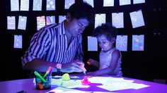 Adam Brindley and son Finn, 2, play at the MCA's Light Lab kids space, which is attached