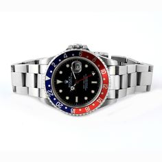 Rolex GMT satinless steel . Blue and red.