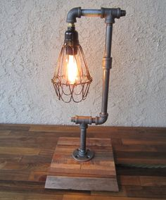 Edison Trouble Light Desk Lamp Vertical, Pipe, Reclaimed Wood Base - BULB INCLUDED / Vintage Industrial Lamp / Steampunk Light / Table Lamp. $125.00, via Etsy.