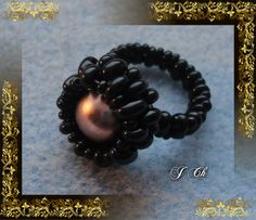 Černý s perlou v barvě mědi