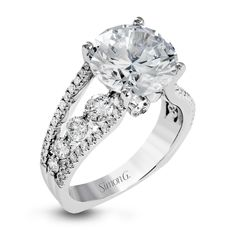 This amazing 18k white gold engagement ring contains 1.66 ctw of white round brilliant diamonds in a modern yet classic design.