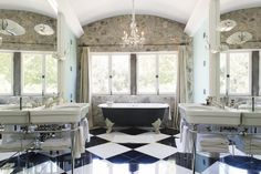 The master bathroom has a clawfoot bathtub and black and white tiles.