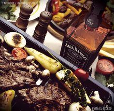Una asada y de compañía un Jack Daniels