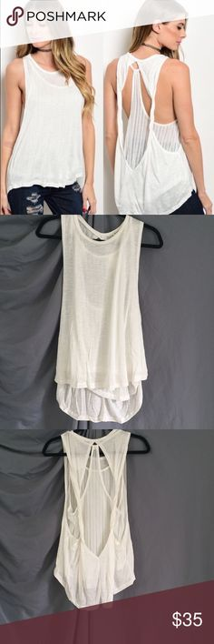 NWT 1 Left! White top NWT top. White, but not bright white, top that has a small sheer inner layer and a loose outer. This is the last one! en creme Tops Tank Tops
