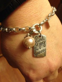 Origami Owl dangle bracelet... FREE CHARM WITH A $25 OR MORE PURCHASE... Contact me to place your order YourCharmingLocket@gmail.com or message me on Facebook https://www.facebook.com/YourCharmingLocket. Want more than just one locket, consider joining our team for an extra income.