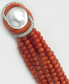 Art Deco Coral, pavé diamond, pearl, gold and platinum bracelet. Cartier, Paris.