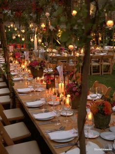 Branches attached to the sides of trestle tables and hung with mini-tealight lanterns distract all attention from the marquee, leaving the grass uncovered, weather permitting, adds to the outdoor aesthetic