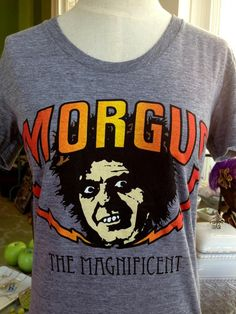 Fleurty Girl - Everything New Orleans - Morgus the Magnificent Throwback Tee, $25. We love us some Morgus!