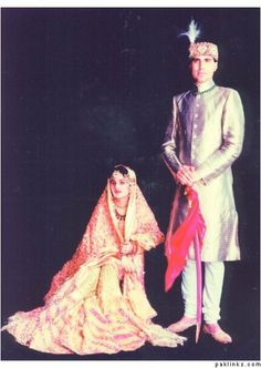 Nawab Kazim Ali Khan & his Begum - It's basically a farshi gharara with so much gher that it drags on the floor for several feet...so much so that you basically have to fold the fabric ...