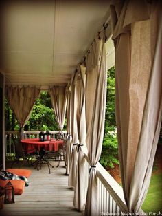 Make Drop Cloth Curtains for Outdoor Spaces and Porches.    Of course I'd have to make the porch first, but a girl can dream.