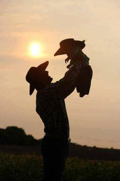 Sweet little cowboy w his dad
