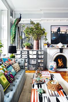 14 Small Space Hacks to Make Your Studio Apt Seem HUGE Amazing eclectic living room with fireplace and a lot of storage place. Love the colorful pillows and the elegant design of the couch! Interior Exterior, Home Interior, Bathroom Interior, Modern Interior, Japanese Interior, Living Room Decor, Living Spaces, Living Rooms, Usa Living