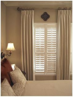 Combining plantation shutters with curtains is a great way to combine decorative beauty with practicality. Curtains add cosiness while shutters give privacy. Consider adding curtains to your shutters to add aesthetic appeal and create warmth in your room. Shutters With Curtains, Lace Curtains, Bedroom Curtains With Blinds, Brown Curtains, Bedroom Window Treatments, High Curtains, Picture Window Treatments, Window Headboard, Unique Window Treatments