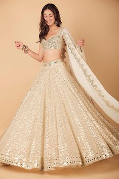 Ananya Panday makes a stunning statement in a gorgeous mirror work lehenga by Abhinav Mishra for Armaan Jain's wedding function. Indian Fashion Dresses, Indian Bridal Outfits, Indian Gowns Dresses, Indian Bridal Fashion, Dress Indian Style, Indian Designer Outfits, Bridal Dresses, Pakistani Clothing, Abaya Style