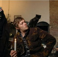 Norman Reedus and his kitten.
