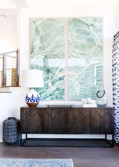 San Clemente Reveal | Part Two - Blackband Design  Coastal vignette. Water artwork, coastal artwork, ocean artwork. Dark wood sideboard/ wood detailing on custom console.