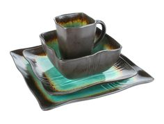 This Earthtone 16-piece dinnerware set will add a modern and unique feel to your dinner table. The square shapes of the dinnerware combined with the teal and brown earth tones will bring your dinner table to life.