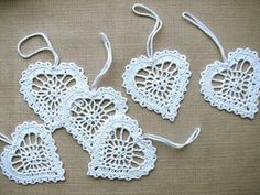 White hearts - set of 6 - handcrochet of white cotton yarn. Each heart has been stiffened using natural cornstarch to hold the shape. You have many ways to use these hearts - as party favors or put on a greeting card, they can be hung in your Christmas tree or used as home decorations.