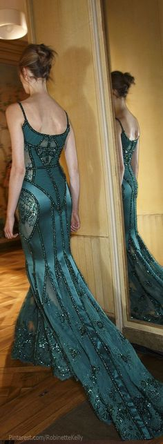 I would never have a reason to wear a dress like this. But id rock it. Beautiful detail.