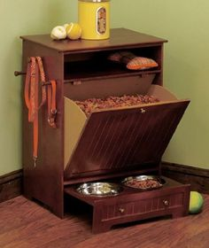 Amazon.com: Pet Food Cabinet with Bowls - WALNUT: Pet Supplies {The reviewer didn't like this for the quality, but I like the idea of it.}